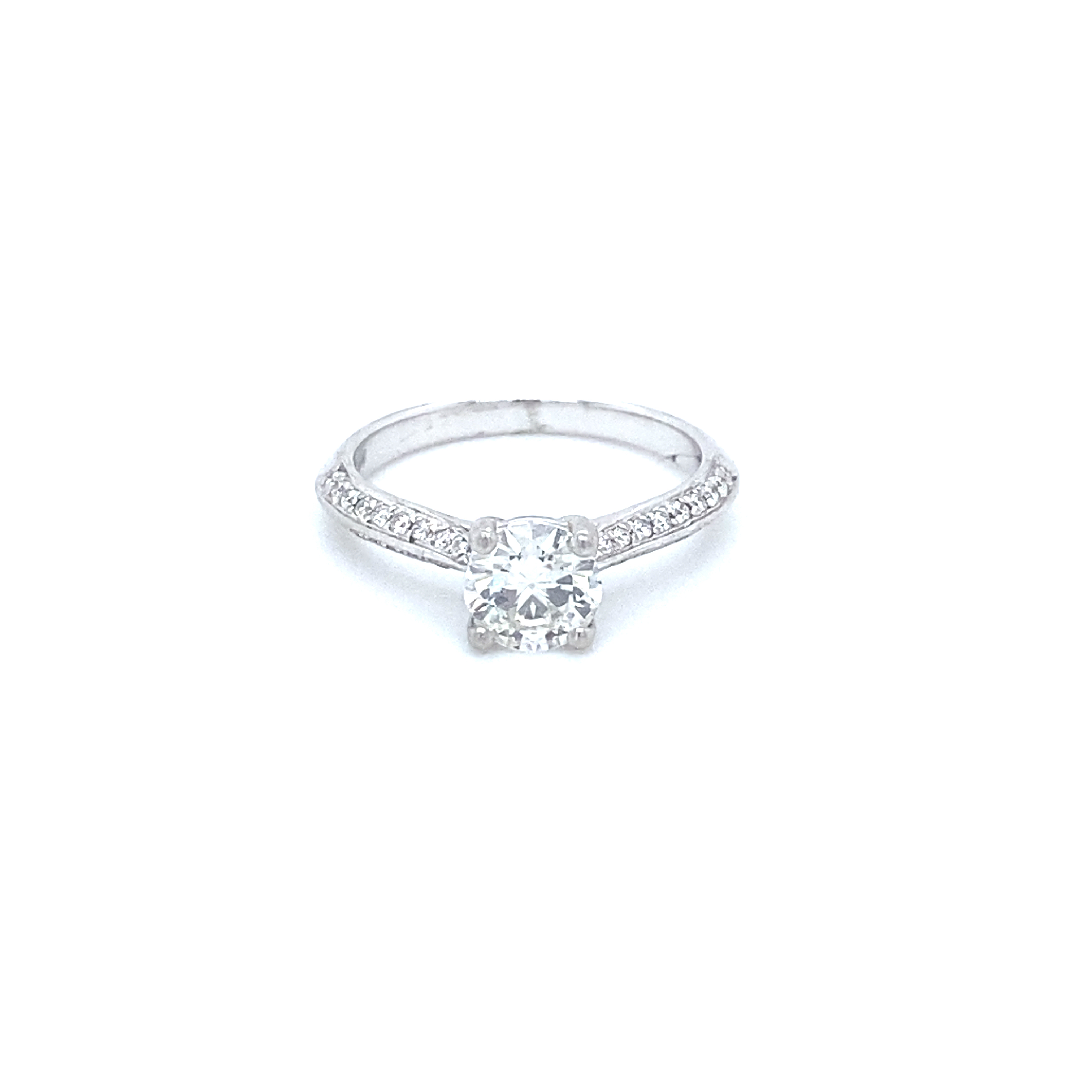 A diamond ring, with pave set diamond shoulders, in platinum