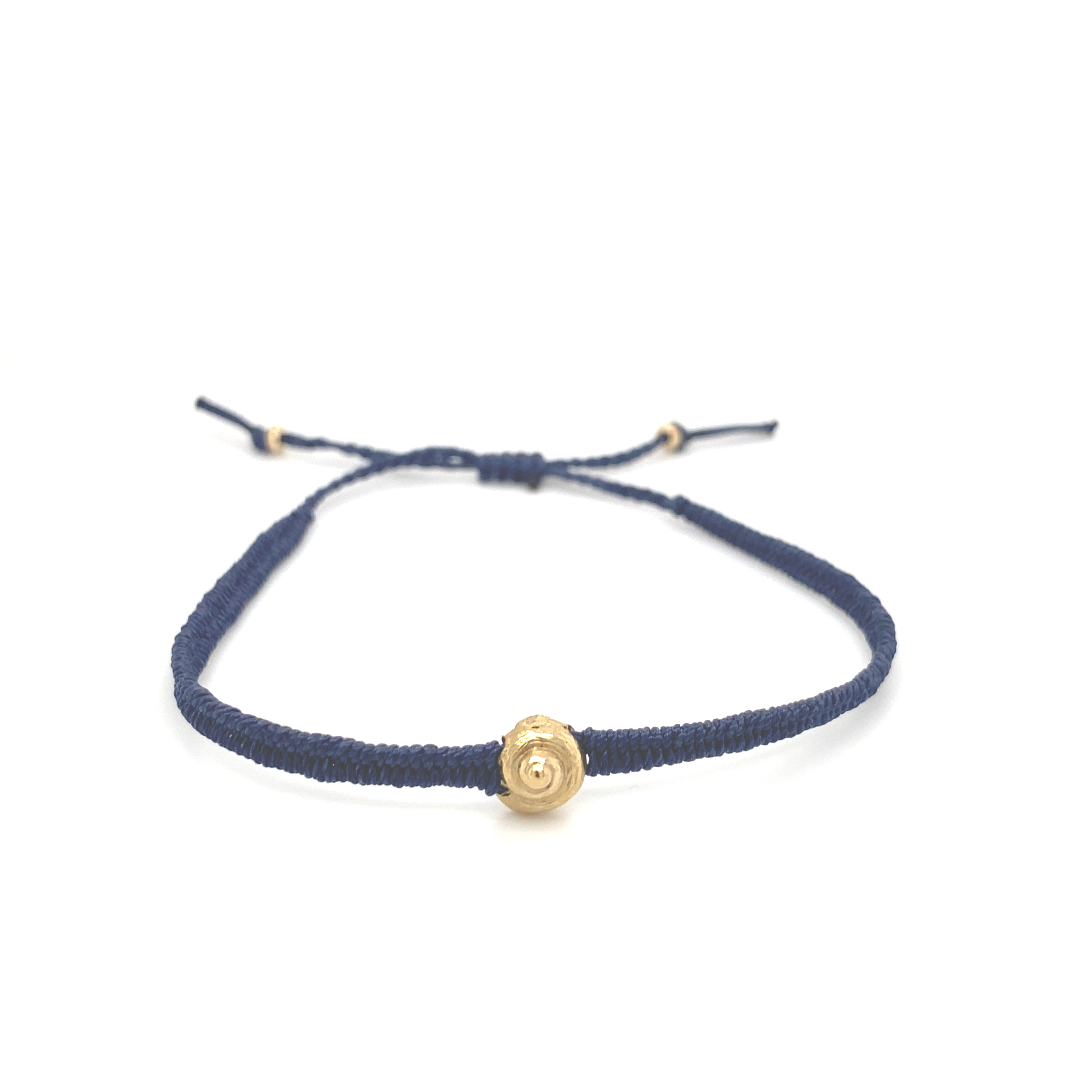 A gold shell and silk charm bracelet