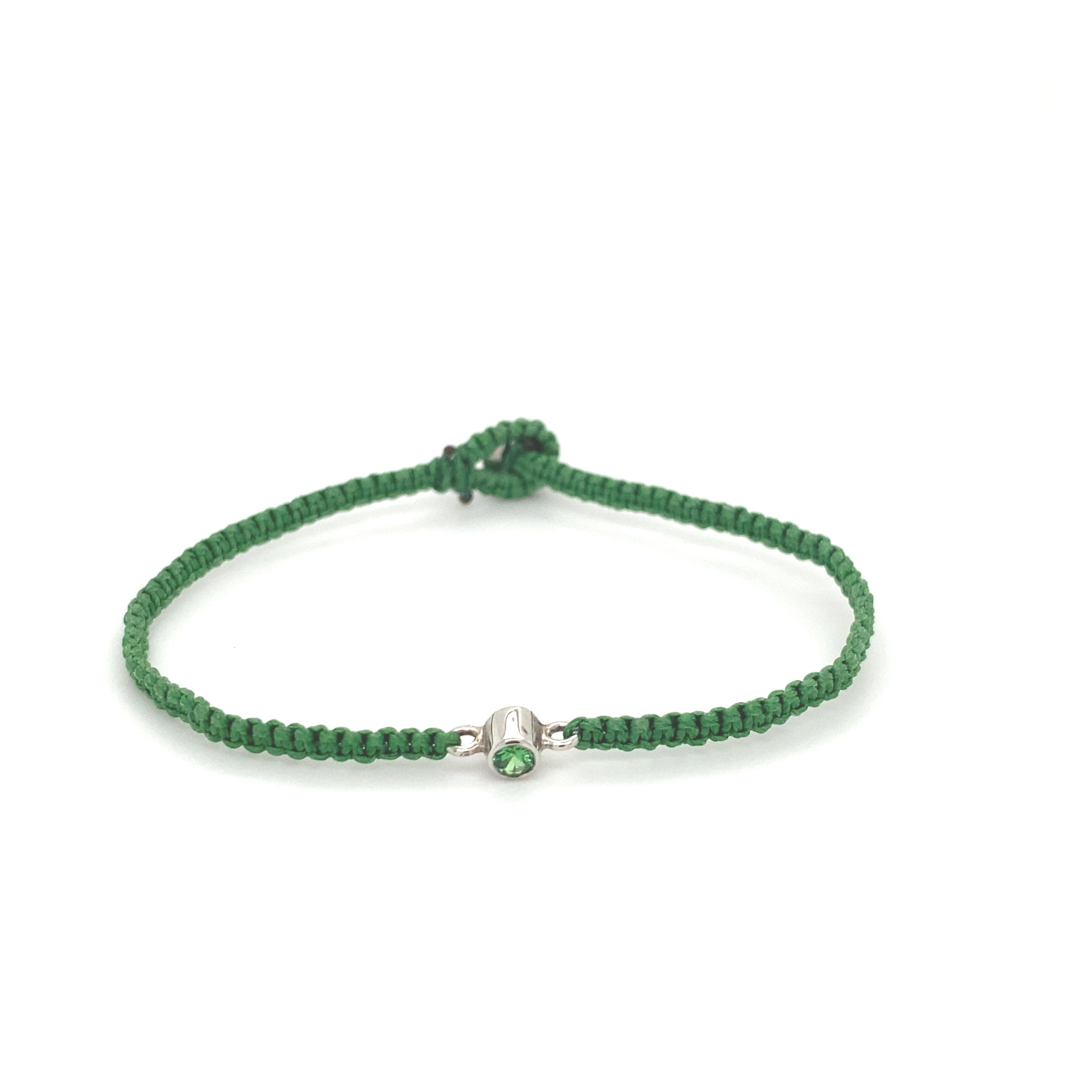 A Tsavorite and white gold gem set silk bracelet