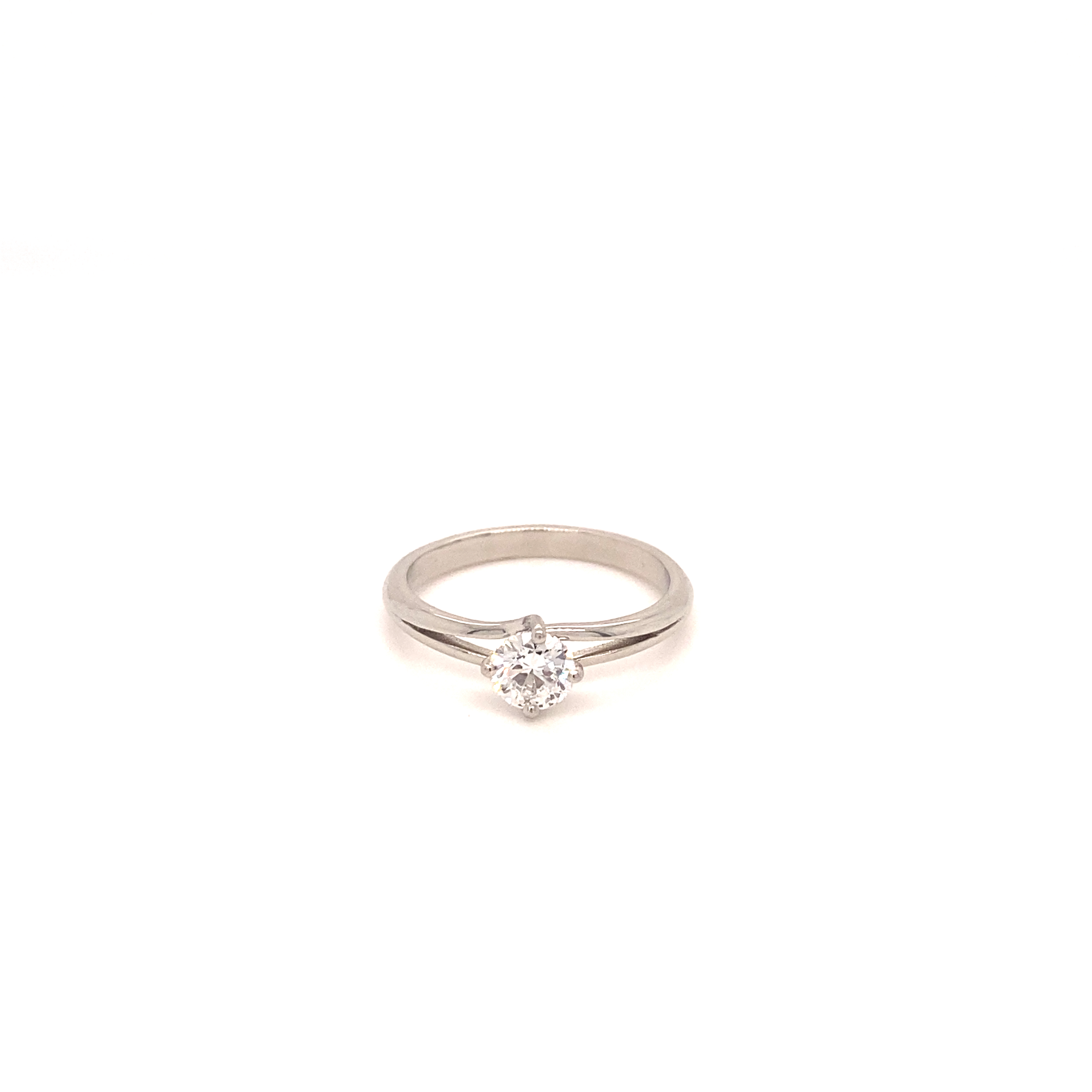 A diamond ring, set within a platinum twist mount.